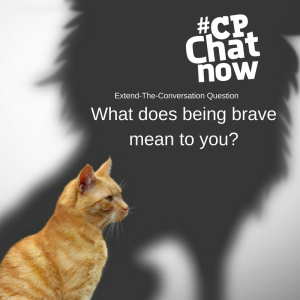 An orange cat sitting and looking at its shadow which is a lion. Extend-The-Conversation-Question along with What does being brave mean to you? along with #CPChatNow white logo in the upper right hand corner