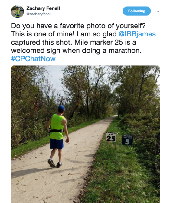 zach sharing his favorite photo of him passing mile marker 25 during his marathon