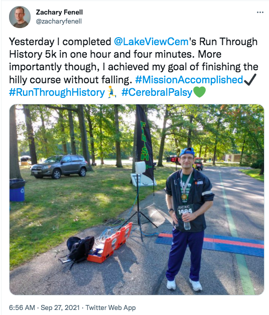 zach tweets he completed the 5k in one hour, 4 minutes and achieved his goal of not falling on the hilly course. there is a picture of zach standing by the finish line